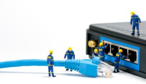 technicians-connecting-network-cable_zkAdn9A_